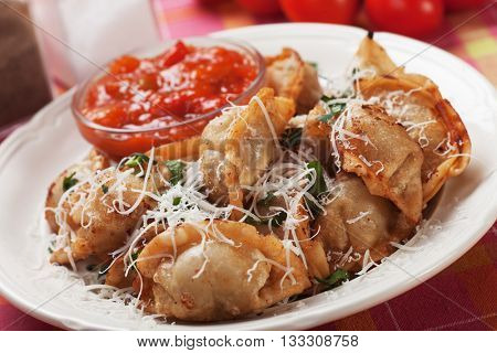 Deep fried asian wonton noodles with chili sauce