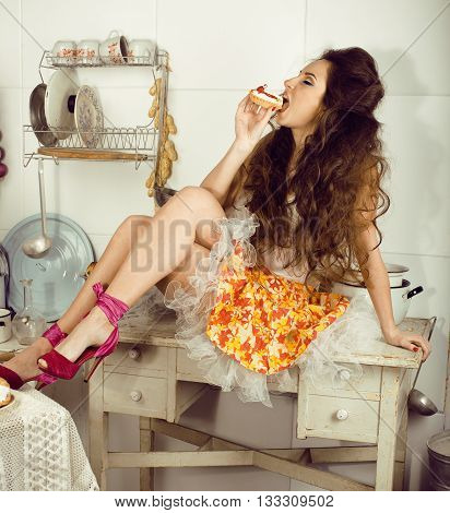 crazy real woman housewife on kitchen, eating perfoming, bizare girl celebrating womans day