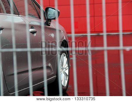New car behind security greed near car shop