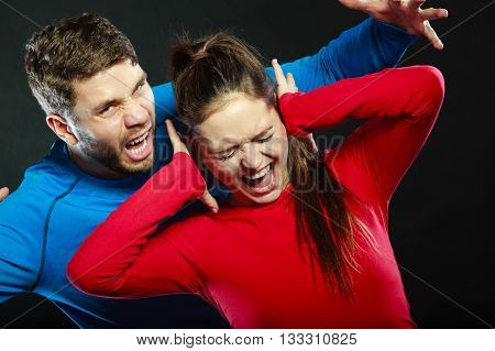 Aggresive man screaming at crying scared woman. Domestic violence aggression. Bad relationship.