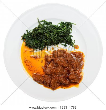 Wild boar stew with hot sauce and spinach isolated on white