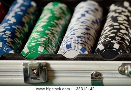 Stack of Casino chips in a silver case