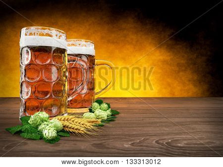 two oktoberfest glasses of beer with barley and hops- 3D render