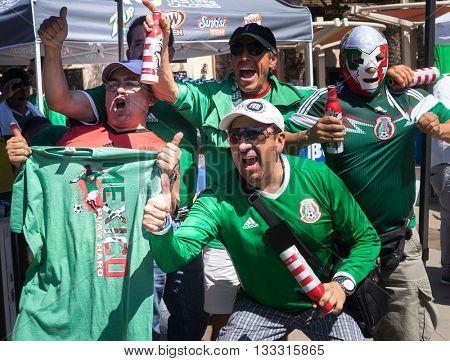 Glendale,Westgate,Phoenix,Arizona,USA, Jun 5th,2016. Mexico vs Uruguay 2016 Copa America Centenario. Colorful Mexico fans celebrate outside stadium after 3:1 victory.