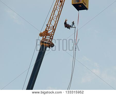 Bydgoszcz, Poland - June 05, 2016: Young girl jumps on bungee during the festival in Bydgoszcz.