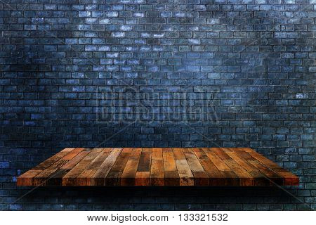 Empty wooden shelves and dark brick wall background. For display or montage your products.