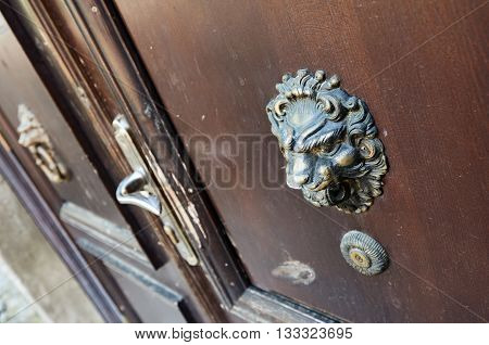 old style lion's head knocker on the door. Ukraine Dubno Carpathian