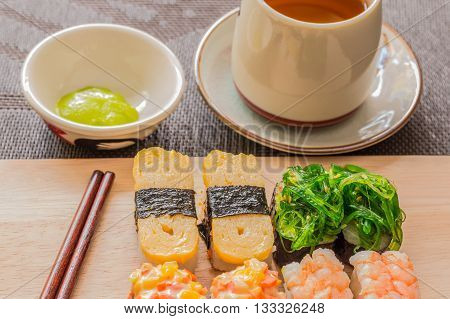 Sushi Set With Chop Sticks, Wasabi Served On Wooden Slate, Selective Focus - Sushi Is Food Originati
