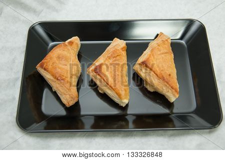 Puff pastry pie with curry chicken on plate
