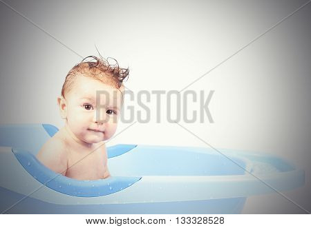 Happy Little Babe Is Bathed In Blue Basin