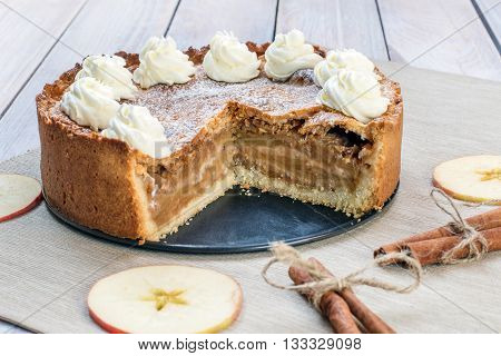 Sliced Apple Pie With Whipped Cream With Cinnamon And Apple Slices