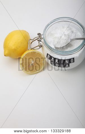 Spoonful of baking soda and lemon fruits for multiple holistic usages