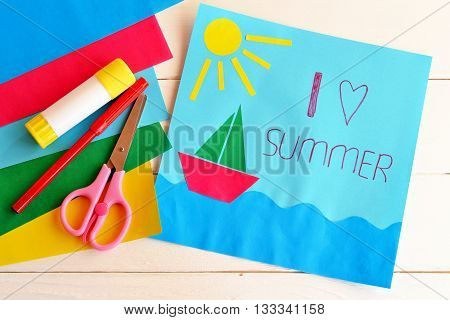 Card with text I love summer. Paper ship, sun, sea applique. Vacation pattern. Red pen, glue stick, scissors, colored paper. Fun art idea for kids. Summer vacation background. Summer vacation concept