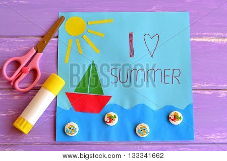 Fun paper holiday card. I love summer. Paper card with sun, ship, sea, fish buttons. Pink scissors, glue. Summer camp idea for kids. Development of children creative skills. Children creativity lesson