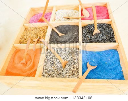 colorful sands and rocks in wooden box art plant decoration in a glass pot by stones and sand Color