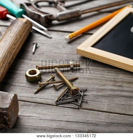 Old building tools on a wooden table with space for your text. Building tools background
