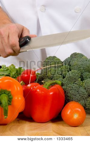 Fresh Vegetables On Cutting Board With Knife