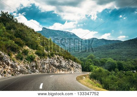 Beautiful Open Asphalt Mountain Road Under Sunny Blue Sky. Verdon Gorge In France. French Landscape