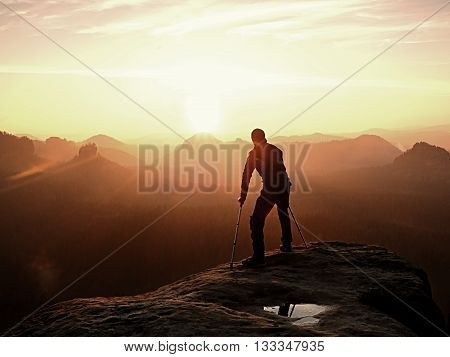 Bended Man With Broken Leg And Medicine Crutch.  Hiker With Leg In Immobilizer