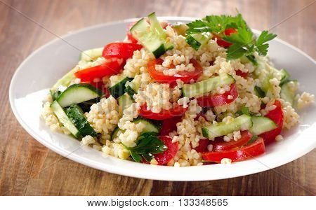 Tabbouleh Salad With Bulgur, Parsley And Fresh Vegetables.
