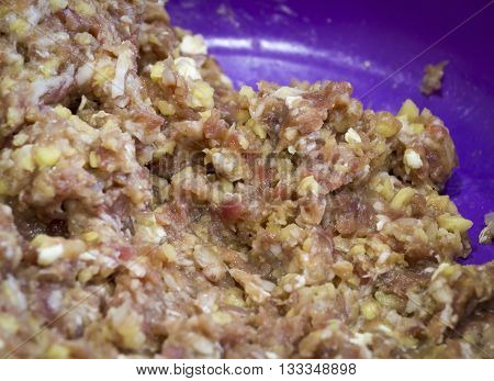 Raw ground meat in a purple plate