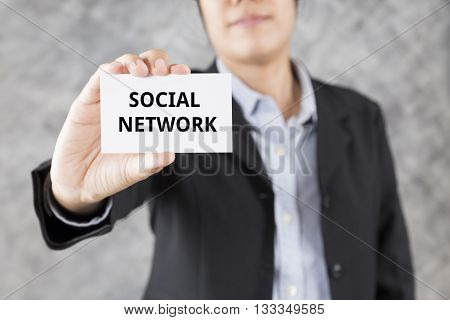 Businessman Presenting Business Card With Word Social Network