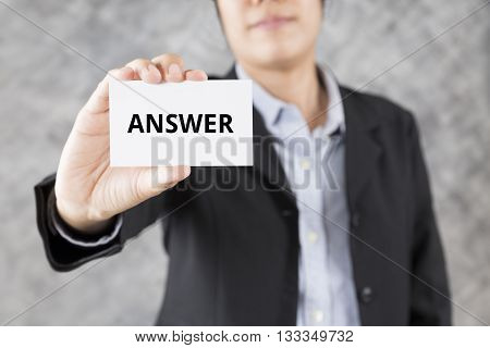 Businessman Presenting Business Card With Word Answer