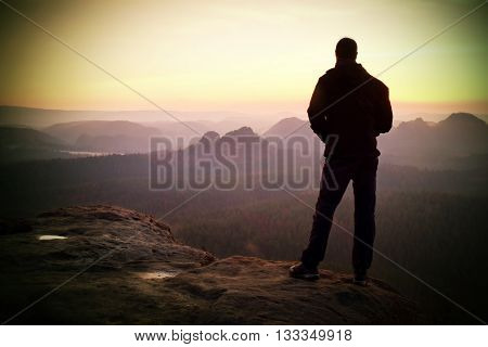Silhouette Of Young Confident And Powerful Man Standing With Hands On Hips, Late Day Sun