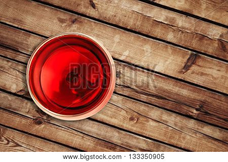 Top Of View Of Red Wine In The Glass Isolated On Wood Background