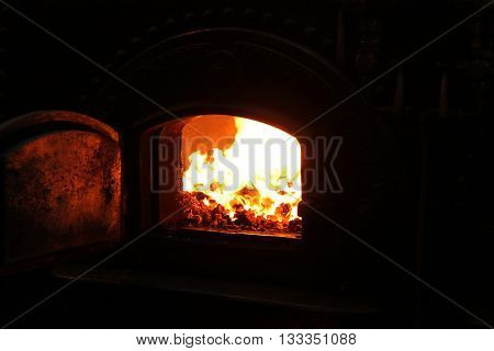 The Roaring Coal Fire of a Vintage Steam Boiler.