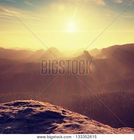 Sandstone Peak Increased From Heavy  Orange Fog. Strong Sunrays