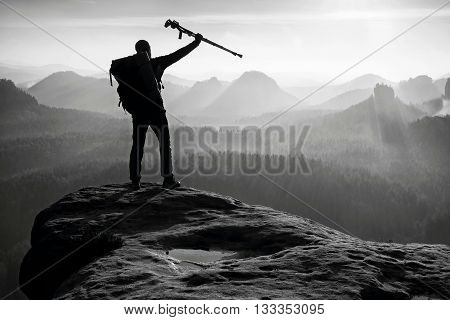 Hiker With Broken Leg In Immobilizer. Deep Misty Valley Bellow Silhouette