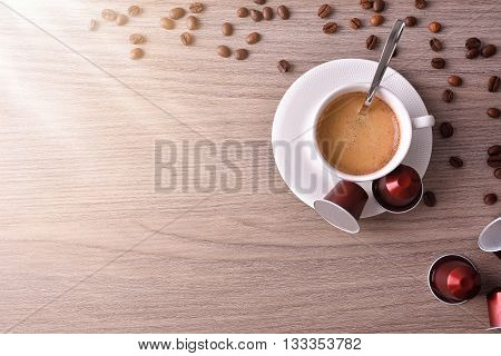 Cup Of Espresso On Wood Table With Shine Top View
