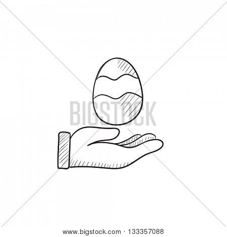 Hand holding easter egg vector sketch icon isolated on background. Hand drawn Hand holding easter egg icon. Hand holding easter egg sketch icon for infographic, website or app.