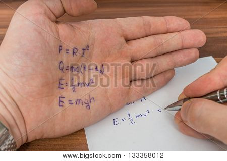Student Is Cheating During Exam With Cheat Sheet With Formula Wr