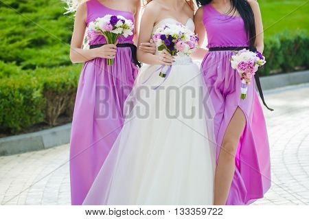 Bride, row of bridesmaids with bouquets at big wedding ceremony. Big wedding bouquets