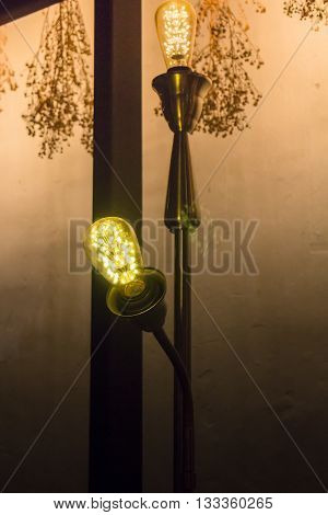 Vintage light bulb in living room stock photo