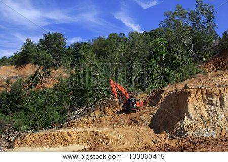 KOTA KINABALU, MALAYSIA - 07 JUNE 2016: Deforestation. Environmental destruction of Borneo rainforest to convert land to oil palm plantations.