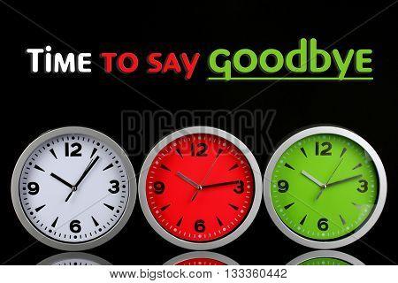 Round office clocks on black background