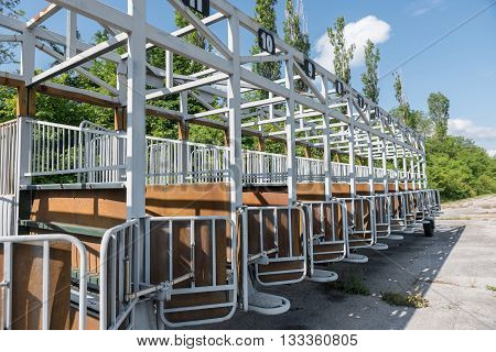 Empty start gates for horse races at park