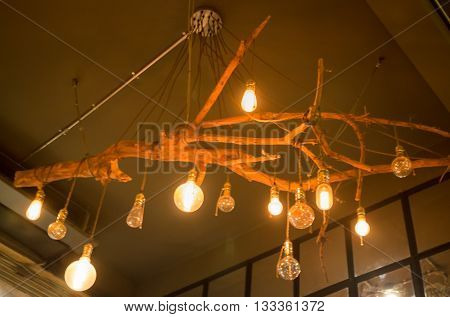Vintage hanging light bulb on room ceiling stock photo