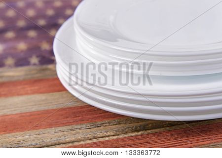 Set of white dishes on table close-up. American cuisine food concept