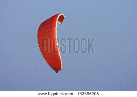 Power kite flying in a blue sky