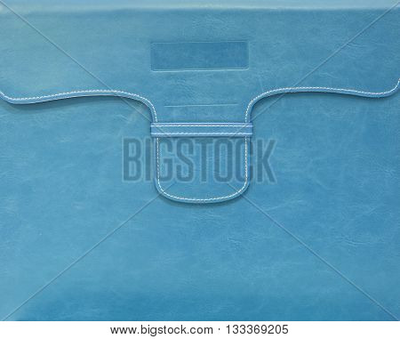 Closeup surface of blue leather bag for document paper background
