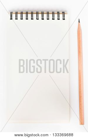 Close up spiral blank notebook with pencil