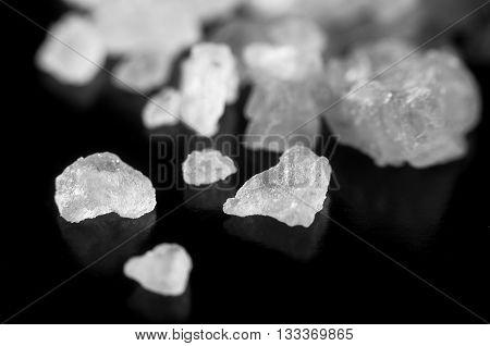 Salt Crystals Scattered On A Black Background Closeup