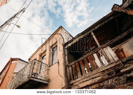 Old Houses With Balconies In The Old Part Of Tbilisi - The Capital Of Georgia. Dilapidated House.