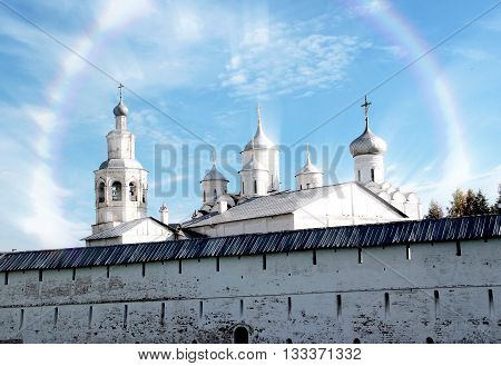 Spaso-Prilutsky Monastery in the Vologda city, Russia. Blue sky and green grass. Castle defense wall