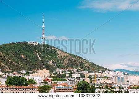The Mtatsminda Mount Is Holy Mountain In Tbilisi, Georgia. On Top Of The Mountain Is 277.4 M Tall Tower, A Park With A Funicular Line And The Restaurant On The Upper Station