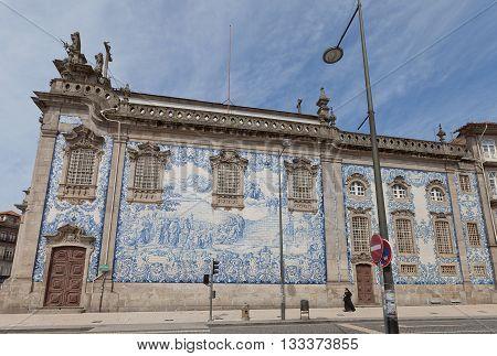PORTO PORTUGAL - MAY 26 2016: Azulejo tiles on the side wall of Carmo Church (18th c.) in the historical center of Porto (UNESCO site). Work of Silvestro Silvestri
